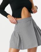 ASOS DESIGN pleated mini skirt in gingham-Multi